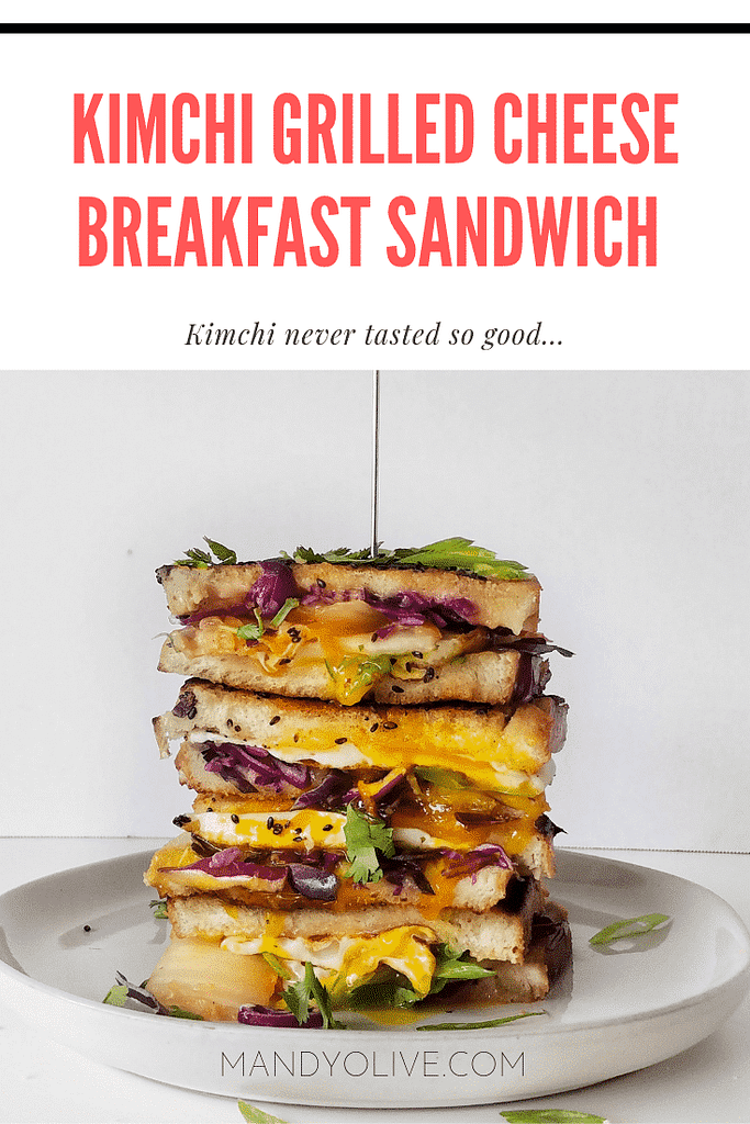 This kimchi grilled cheese breakfast sandwich features a sesame seed crust with mango habanero cheddar cheese, red cabbage, cilantro, scallions, green onions, fried egg sandwich. half baked harvest, bibimbap, korean food, korean fusion, sourdough bread, fancy grilled cheese, brunch,
