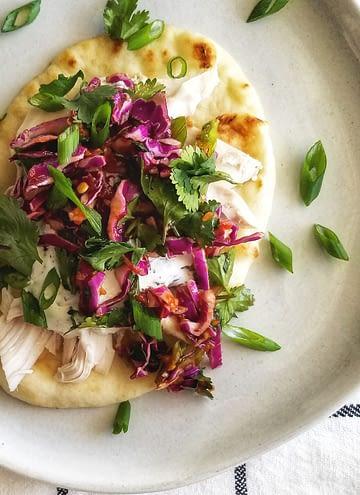 chicken tzatziki tacos with spicy slaw. recipe found on mandyolive.com