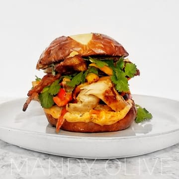 This shredded chicken sandwich is a great weeknight meal idea made in 30 minutes or less. The chicken breast is baked in the oven then pulled apart. Topped with spicy chipotle mayo. This chicken recipe is simple, easy and quick. How to use up leftover chicken? This pulled chicken sandwich recipe is a good dinner recipe for leftovers. The chicken can be made in the slow cooker / crockpot, too! Dinner ideas for meal prep. meal prepping.