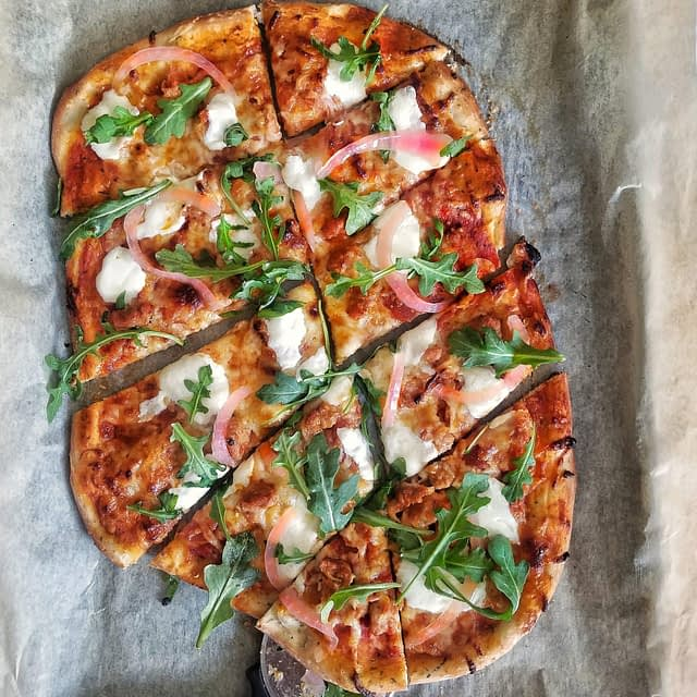 sausage and pepperoni pizza with arugula and pickled red onions. | homemade pizza, gourmet pizza, unique pizza, quick, simple, summer recipes, sheet pan, easy, 30 minute meal idea