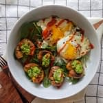 quick and easy breakfast salad made with roasted baby potatoes, pea pesto and fried eggs topped with a creamy dressing and sriracha | potatoes and eggs, pesto recipes, breakfast ideas, brunch recipes, smashed potatoes, crispy, healthy, weight loss, 30 minute meals, fingerling potatoes, eggs with hot sauce, recipes with pesto