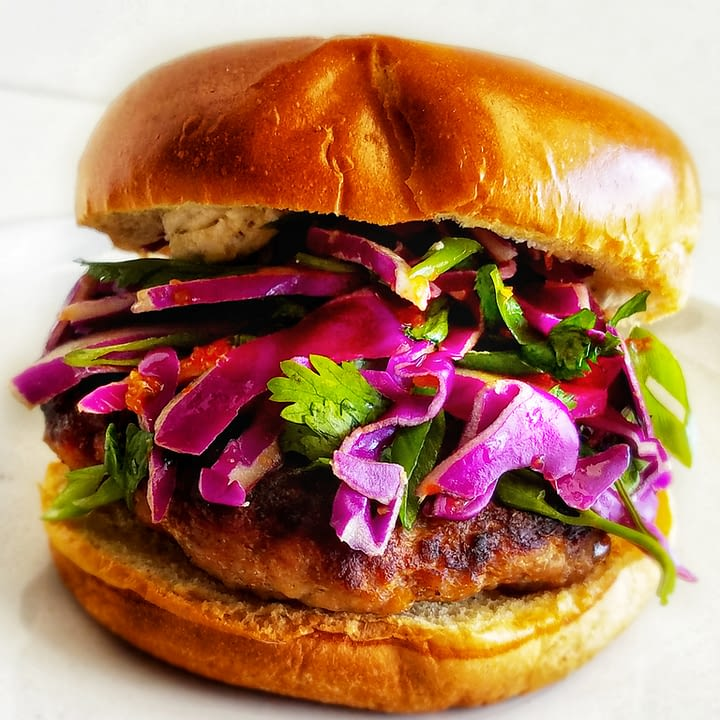 Sweet and spicy pork burgers with red cabbage slaw