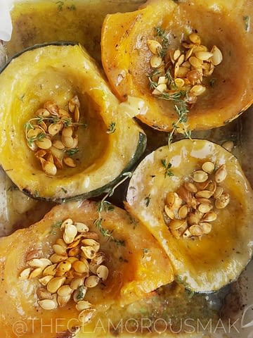 Ever wonder what to do with acorn squash? this recipe will show you how to cook squash in the oven. This roasted squash is dressed with a simple maple tahini dressing for easy side dish ideas to serve with any dinner recipe