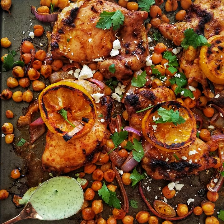 sheet pan chicken thighs with chickpeas and herby yogurt sauce recipe found on mandyolive.com
