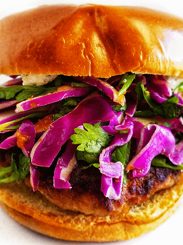 sweet and spicy pork burger with cabbage slaw. recipe on mandyolive.com