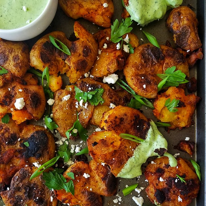 crispy salt and vinegar smashed potatoes with herby yogurt recipe found on mandyolive.com